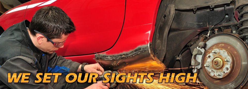 High Caliber Auto Collision & Repair - We Set Our Sights High - grinding bodywork