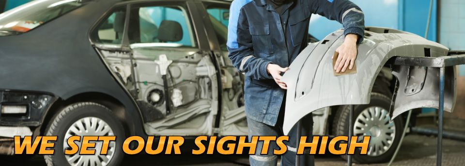 High Caliber Auto Collision & Repair - We Set Our Sights High - wet sanding bumper cover
